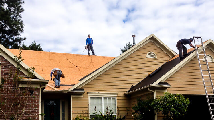 Grace Hiram roofers working on residential roof