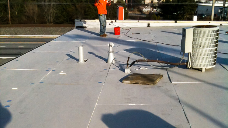 Commercial Roofing Repair Contractors At Work